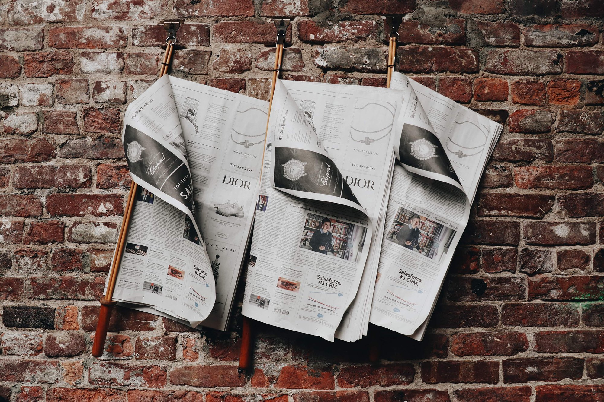 newspaper ads hanging on a wall